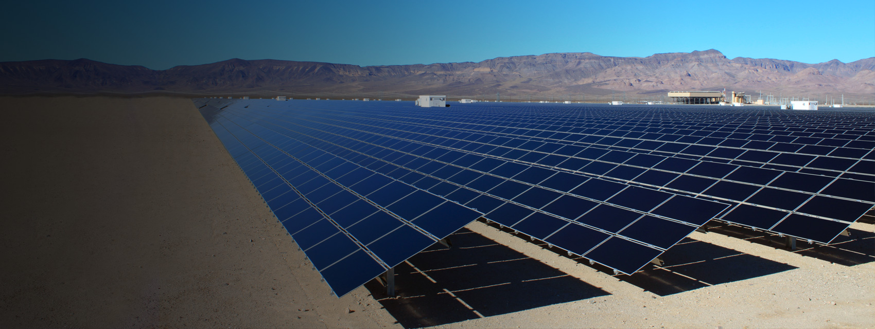 A field of solar panels are positioned to receive sunlight.